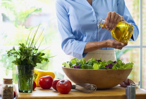 getty rm photo of woman dressing salad